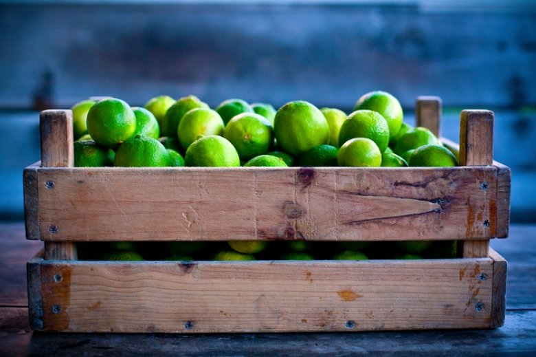 crate of lime fruit