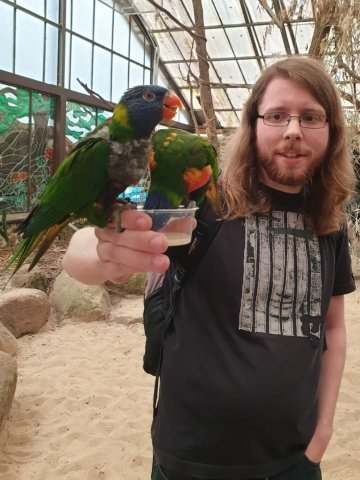 A picture of me with some lorikeets